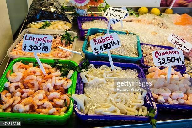 Seafood displayed in shop beside harbour