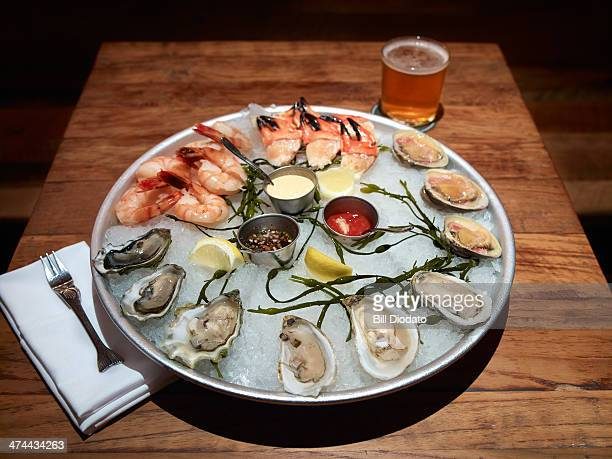 seafood platter on table with drink
