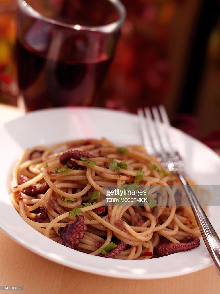 Seafood spaghetti and wine : Stock Photo