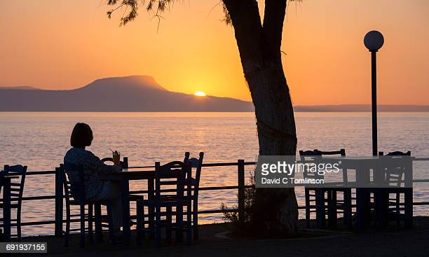 Seafront taverna at sunset, Rethymno, Crete