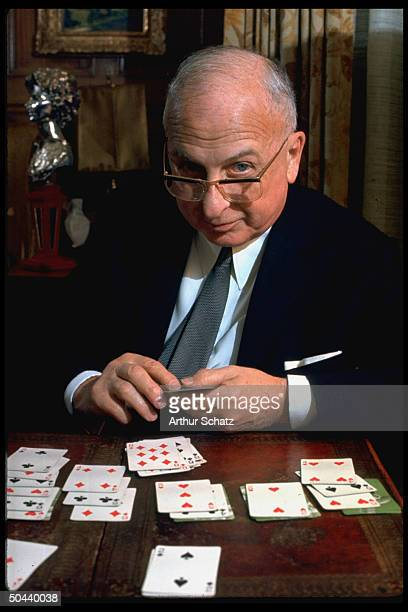 Seagrams founder Sam Bronfman playing game of solitaire