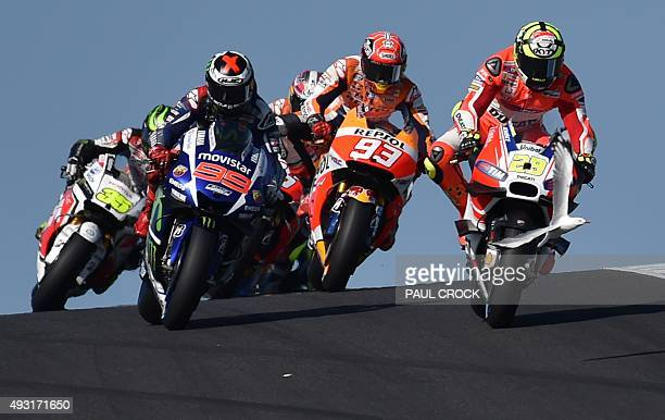 A seagull flies in front of Ducati rider Andrea Iannone of Italy on the opening lap of the MotoGP Australian Grand Prix at Phillip Island on October...