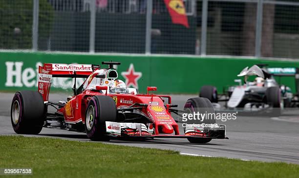 A seagull flies towards Sebastian Vettel of Germany driving the Scuderia Ferrari SF16H Ferrari 059/5 turbo ahead of Lewis Hamilton of Great Britain...
