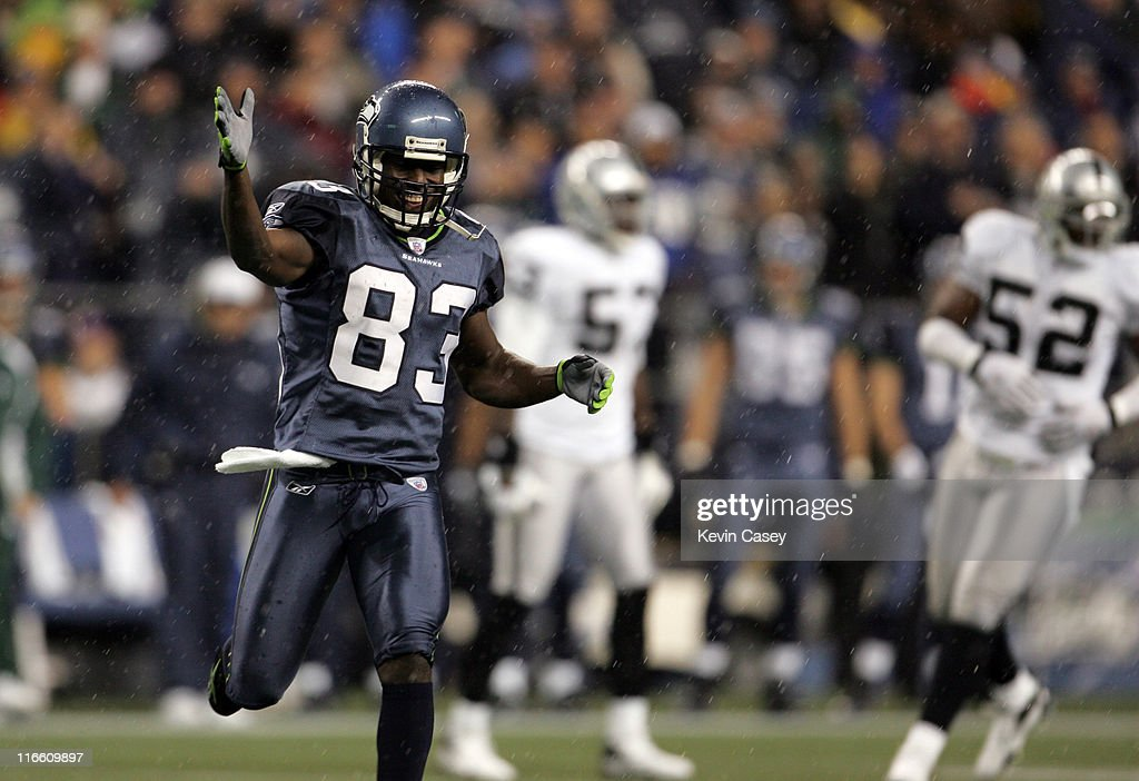 Seahawk's <a gi-track='captionPersonalityLinkClicked' href=/galleries/search?phrase=Deion+Branch&family=editorial&specificpeople=206261 ng-click='$event.stopPropagation()'>Deion Branch</a> signals a first down during first half of the NFL Monday Night Football game on Monday Nov. 6, 2006 at Qwest Field in Seattle, Washington.