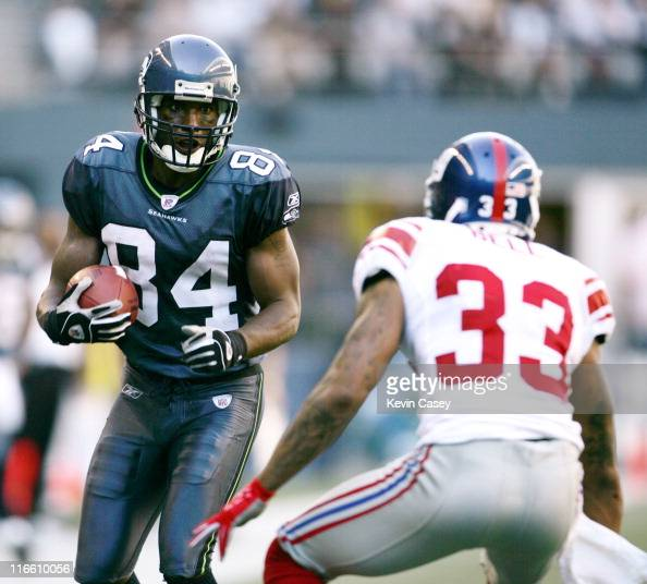 Wide receiver bobby engram in action against giants safety jason