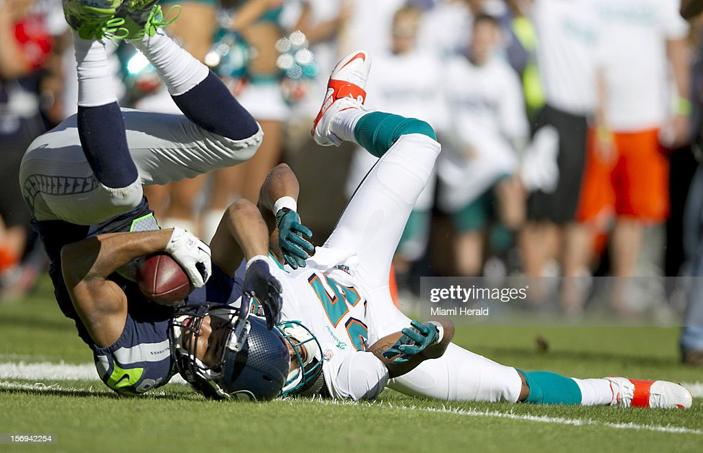 Seahawks wide receiver GoldenTate catches a pass on the five yard line behind defensive back R.J. Stanford (25) in the second quarter as the Miami Dolphins beat the Seattle Seahawks 24-21 at Sun Life Stadium in Miami Gardens, Florida, November 25, 2012.