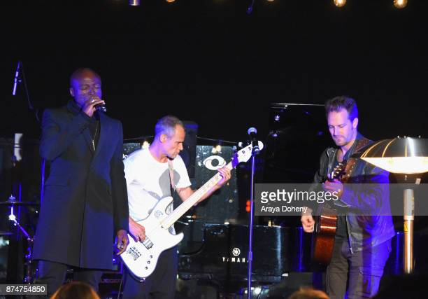Seal Flea and Josh Klinghoffer of the band Red Hot Chili Peppers perform onstage at the Joel Edgerton and Friends host the Inaugural Fundraising Gala...