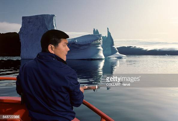 Seal hunting in south coast of Greenland Inuit don't use kayaks and spear anymore but hunt with rifles among the icebergs drifting in the fjord where...