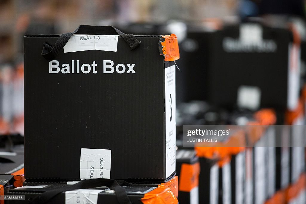Sealed ballot boxes containing voting slips wait to be processed and the ballot papers counted at a count centre in north London on May 6, 2016. Early results Friday from British local and regional elections seen as a key test for opposition Labour leader Jeremy Corbyn showed strong gains for Scottish nationalists, as London looked set to elect its first Muslim mayor. London was on track to become the first EU capital with a Muslim mayor as voters went to the polls Thursday after a bitter campaign between Prime Minister David Cameron's Conservatives and the opposition Labour party. / AFP / JUSTIN