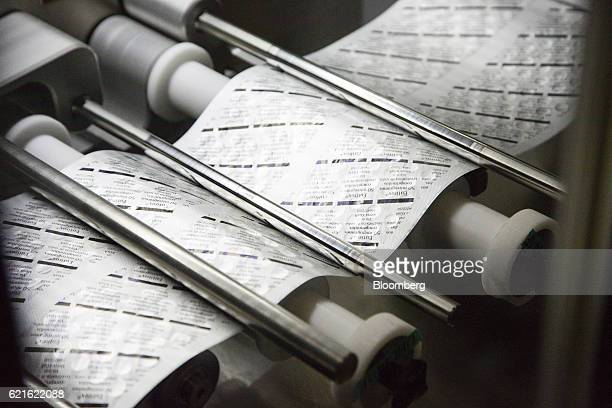Sealed blister packs of Euthyrox hypothyroid treatment tablets pass through a packaging machine inside Merck KGaA's pharmaceutical laboratories at...