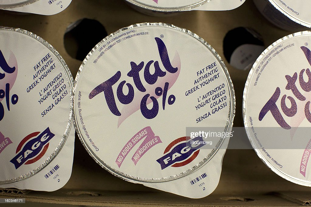 Sealed cartons of Total Greek yoghurt sit in shipping trays after manufacture at the Fage Dairy Industry SA plant in Athens, Greece, on Thursday, Feb. 21, 2013. An October restructuring that placed Fage International SA's Greek units in a subsidiary called Fage Dairy Industry SA coincided with Coca-Cola Hellenic Bottling SA's plan to flee the epicenter of Europe's debt crisis by moving its main stock listing to London from Athens. Photographer: Kostas Tsironis/Bloomberg via Getty Images