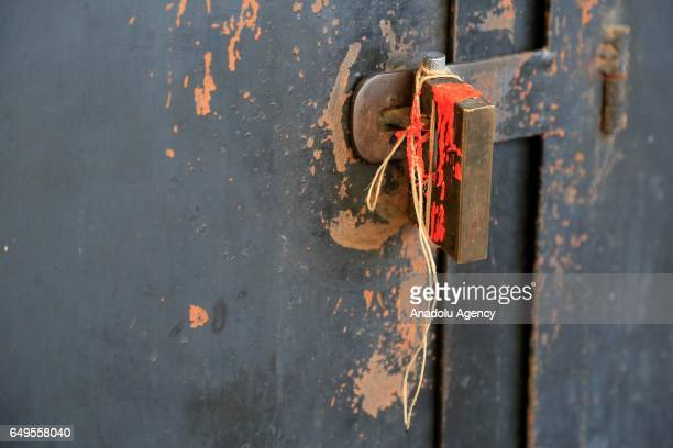A sealed door of an exchange office is seen as Lebanese security forces carry out an antiterror operation against certain exchange offices and money...