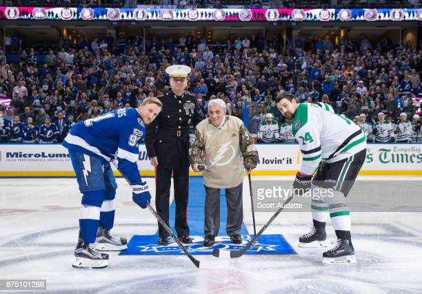 Seaman First Class John Tedesco US Navy is escorted by Lt General William D Beydler US Marine Corps for the ceremonial puck drop between Steven...