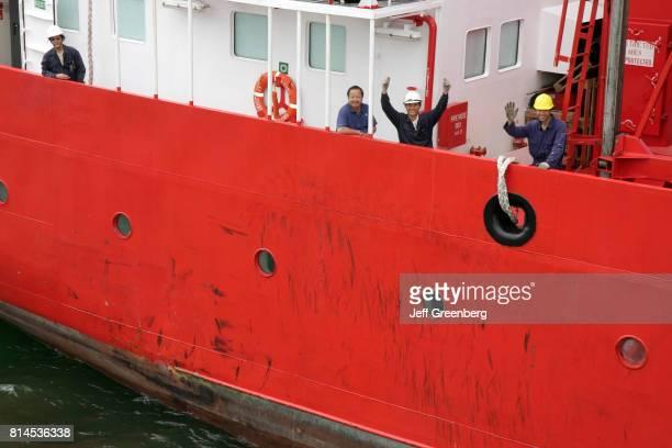 Seamen waving from the Erria Vietnam boat on the Miami River