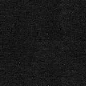 Seamless grainy dotted uniform plain black paper card background texture.