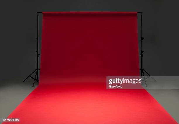 Seamless red background paper hanging on stands-isolated on grey