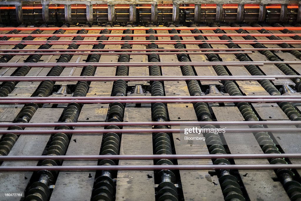Seamless steel pipes cool on a conveyor after rolling at the Interpipe LLC seamless pipe factory in Nikopol, Ukraine, on Wednesday, Jan. 30, 2013. Ukraine's Interpipe Group, owned by billionaire Victor Pinchuk, opened a $700 million electric steel mill in Dnipropetrovsk with an annual output capacity of 1.32 million tons of steel for its seamless pipe production. Photographer: Vincent Mundy/Bloomberg via Getty Images
