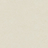 Seamless washy sandy grainy plain light beige paper texture background.