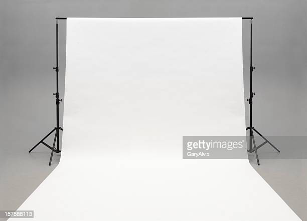 Seamless white background paper hanging on stands-isolated on grey