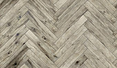Seamless flooring texture in herringbone pattern for indoor design rendering.