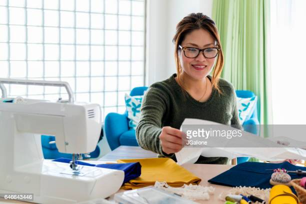 Seamstress checking a pattern