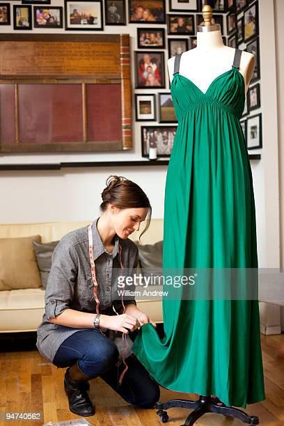 Seamstress hemming dress