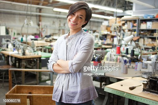 Seamstress in clothing factory : Stock Photo