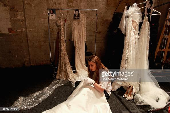 A seamstress makes adjustments backstage ahead of the Steven Khalil show at MercedesBenz Fashion Week Australia 2015 at Carriageworks on April 15...