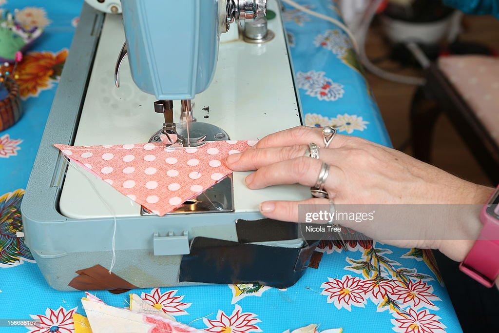 seamstress sewing at machine. : Stock Photo