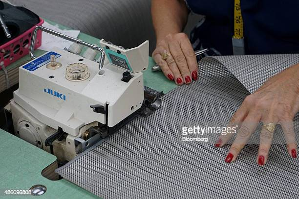 A seamstress sews a piece of seating material at the Pavilion Furniture Inc manufacturing facility in Miami Florida US on Friday Aug 28 2015 The...
