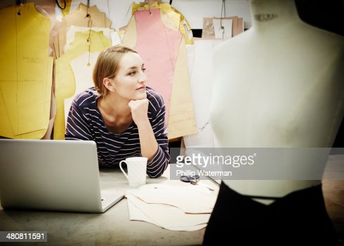Seamstress working at table : Stock Photo