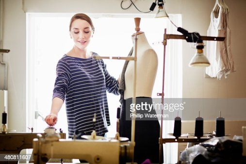 Seamstress working at tailors dummy