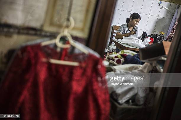 A seamstress works in the shop of Sok Kha 72