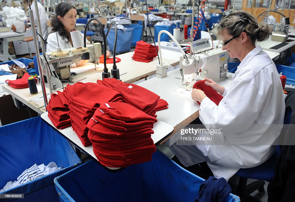 Seamstresses make red bonnets October 31, 2013 at the textile factory Armor Lux in Quimper, western France. These red bonnets became a symbol of anger in Brittany's social crisis.