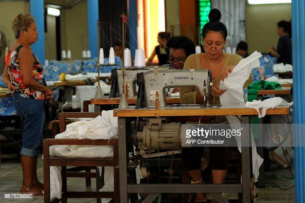 Seamstresses sew in at a workshop in Havana on October 27 2017 Almost drowned by the crisis of the 90s the emerging Cuban fashion begins to thrive...