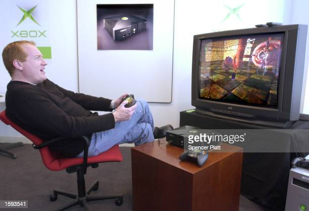 Seamus Blackley director of Advanced Technology Group demonstrates Microsoft's new Xbox video game February 12 2001 in New York The game will be...