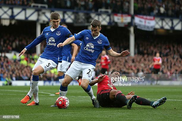 Seamus Coleman and John Stones of Everton challenge Anthony Martial of Manchester United during the Barclays Premier League match between Everton and...