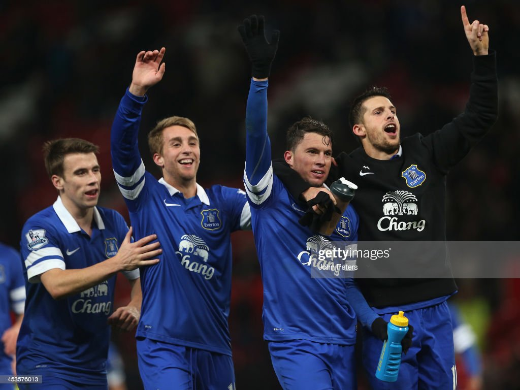 Seamus Coleman, Bryan Oviedo and Kevin Mirallas of Everton celebrate after the Barclays Premier League match between Manchester United and Everton at Old Trafford on December 4, 2013 in Manchester, England.