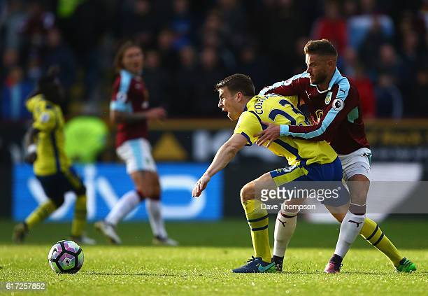 Seamus Coleman of Everton and Michael Kightly of Burnley compete for the ball during the Premier League match between Burnley and Everton at Turf...