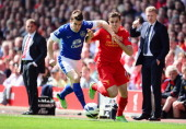 Seamus Coleman of Everton battles for the ball with Jordan Henderson of Liverpool during the Barclays Premier League match between Liverpool and...