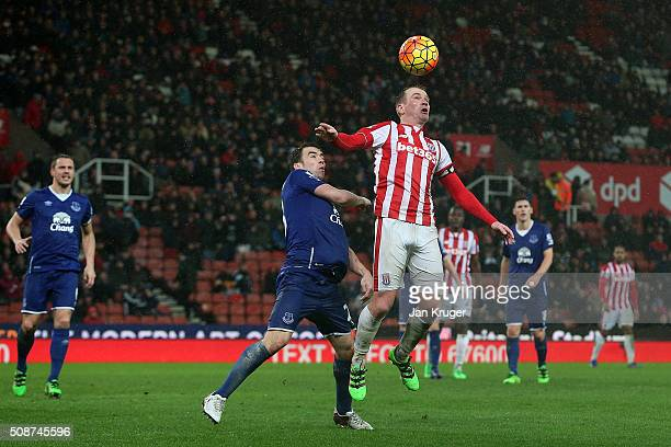 Seamus Coleman of Everton battles with Glenn Whelan of Stoke City during the Barclays Premier League match between Stoke City and Everton at...