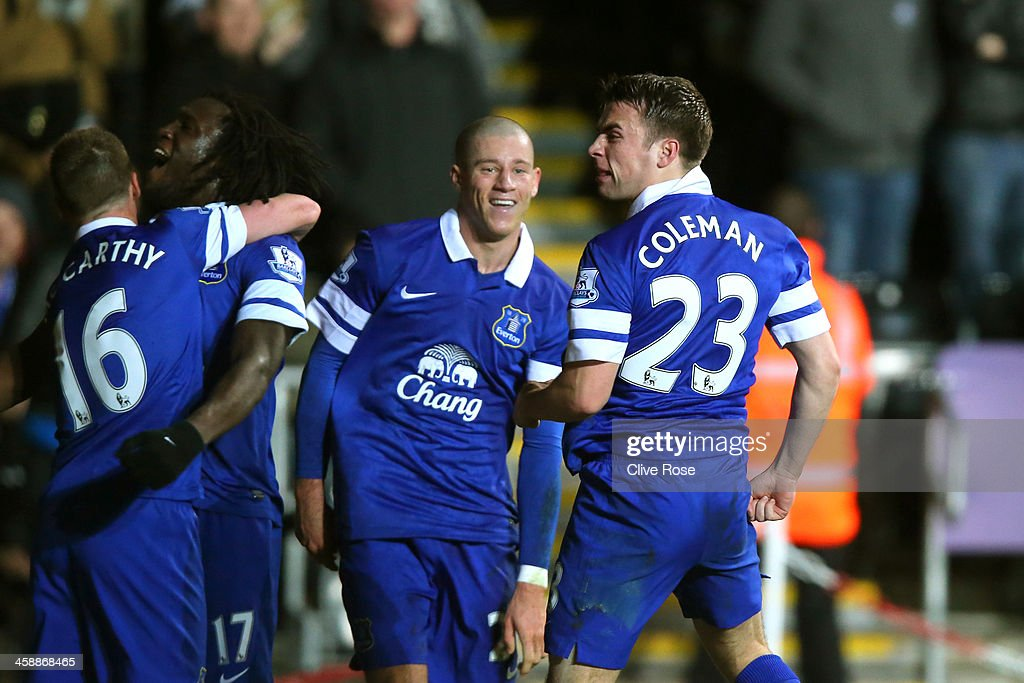 Seamus Coleman (R) of Everton celebrates after scoring the opening goal during the Barclays Premier League match between Swansea City and Everton at the Liberty Stadium on December 22, 2013 in Swansea, Wales.