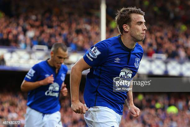 Seamus Coleman of Everton celebrates scoring their third goal during the Barclays Premier League match between Everton and Aston Villa at Goodison...