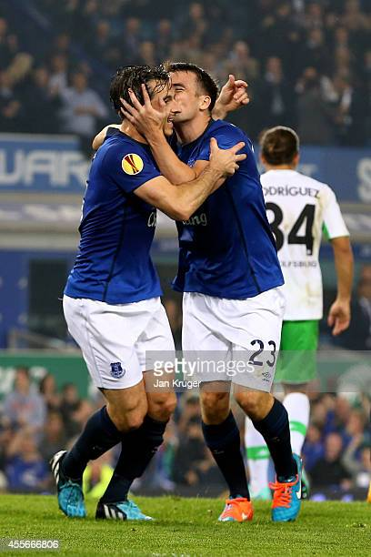 Seamus Coleman of Everton celebrates with teammate Leighton Baines of Everton after scoring his team's second goal during the UEFA Europa League...