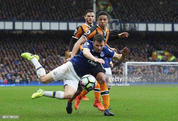 Seamus Coleman of Everton is challenged by Curtis Davies of Hull City during the Premier League match between Everton and Hull City at Goodison Park...
