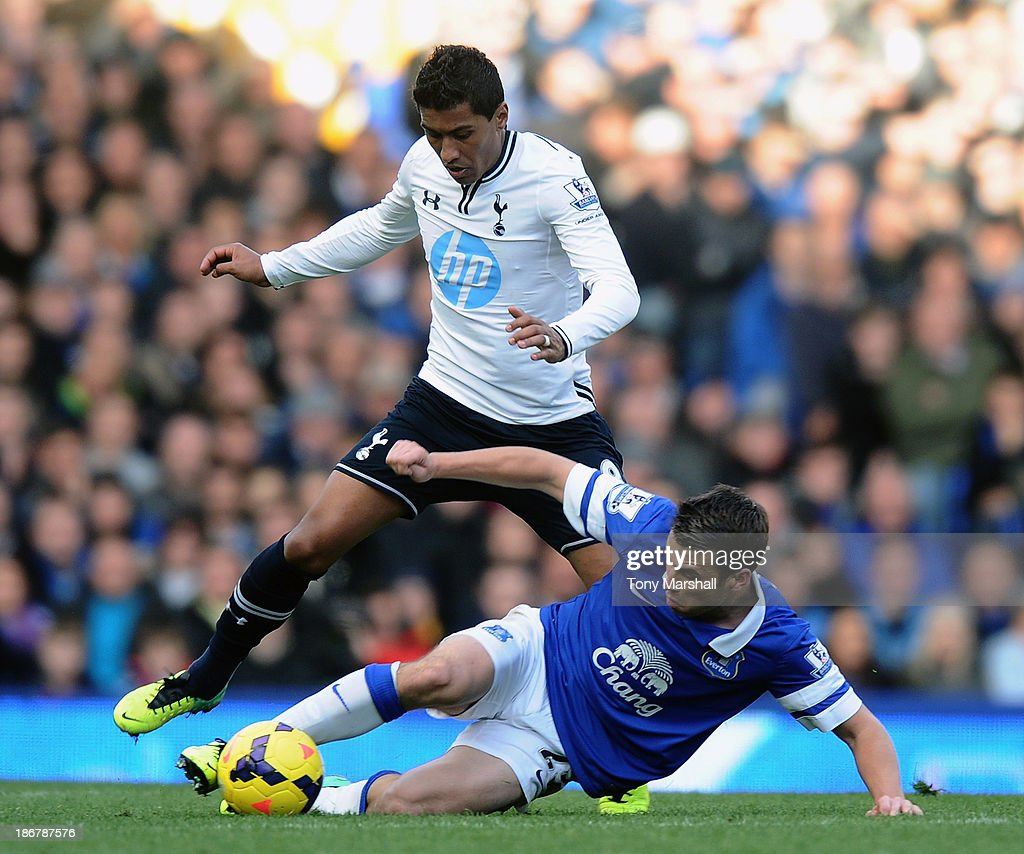 Seamus Coleman of Everton is tackled by Paulinho of Tottenham Hotspur during the Barclays Premier League match between Everton and Tottenham Hotspur at Goodison Park on November 3, 2013 in Liverpool, England.
