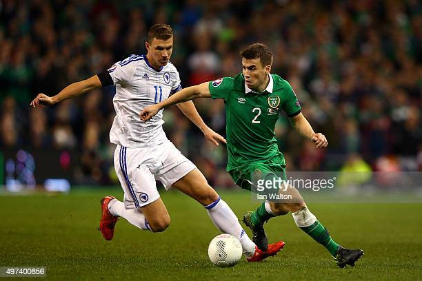 Seamus Coleman of the Republic of Ireland is closed down by Edin Dzeko of Bosnia and Herzegovina during the UEFA EURO 2016 Qualifier play off second...