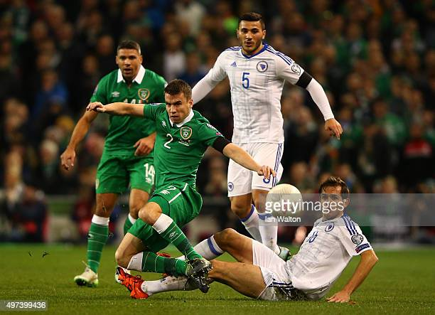 Seamus Coleman of the Republic of Ireland is tackled by Senad Lulic of Bosnia and Herzegovina during the UEFA EURO 2016 Qualifier play off second leg...