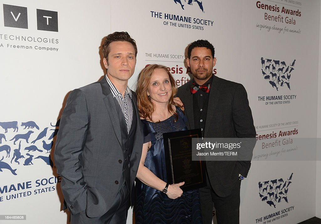 Seamus Dever (L) and John Huertas (R) pose backstage with producer Jenny Dubin and the Outstanding Newsmagazine award at The Humane Society of the United States 2013 Genesis Awards Benefit Gala at The Beverly Hilton Hotel on March 23, 2013 in Los Angeles, California.