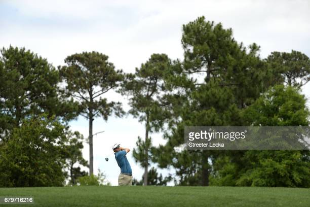 Seamus Power of Ireland plays an approach shot on the fourth hole during round three of the Wells Fargo Championship at Eagle Point Golf Club on May...